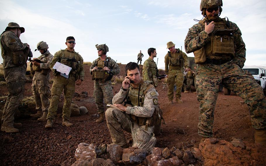 A forward observer from New Zealand calls in an airstrike during the Rim of Pacific exercise at Pohakuloa Training Area, Hawaii, Saturday, July 14, 2018.