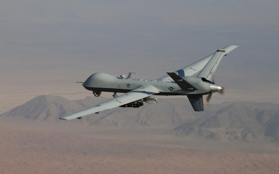 An MQ-9 Reaper, armed with GBU-12 Paveway II laser-guided munitions and AGM-114 Hellfire missiles, flies a combat mission over southern Afghanistan. The U.S. military is now conducting armed drone flights over Niger, which the country's top defense official says is intimidating local extremists.