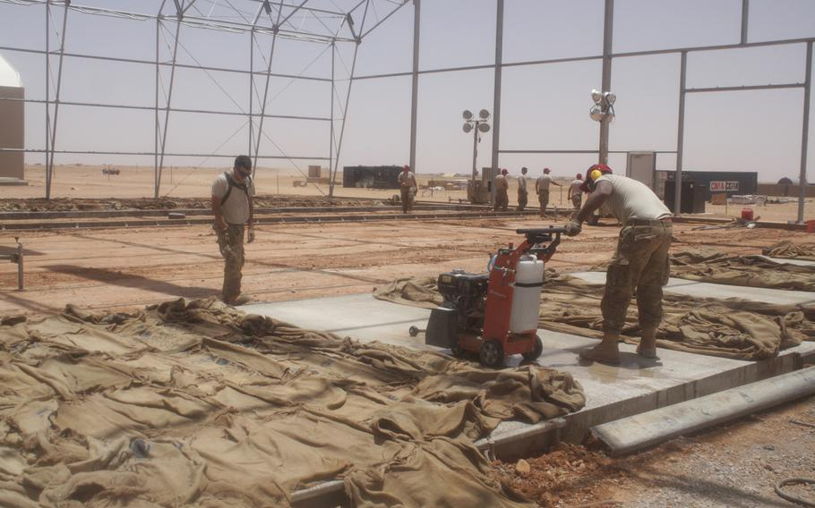 Airmen work in the unmanned aerial device apron in Agadez, Niger, in April, where drones will be parked when they are not in operation.The U.S. military is now conducting armed drone flights over the African country.