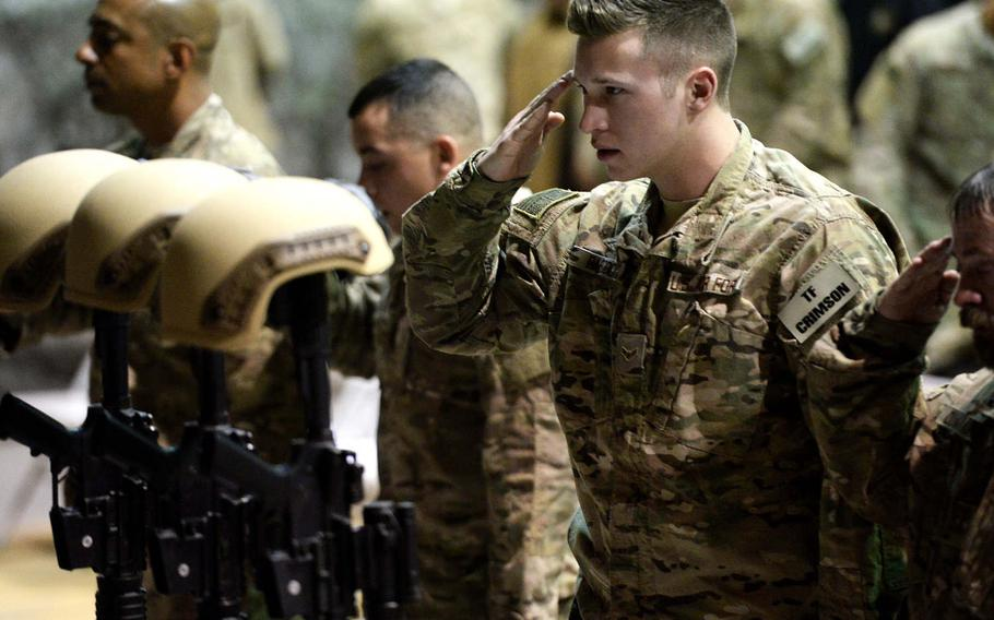 An airman salutes his fallen comrades on Wednesday, Dec. 23, 2015, at Bagram Air Field, Afghanistan, during a memorial service for six airmen killed in a suicide bombing two days earlier. One of those killed was Staff Sgt. Peter Taub. A post office in Wyncote, Pa., was renamed for Taub on Monday.   Stars and Stripes