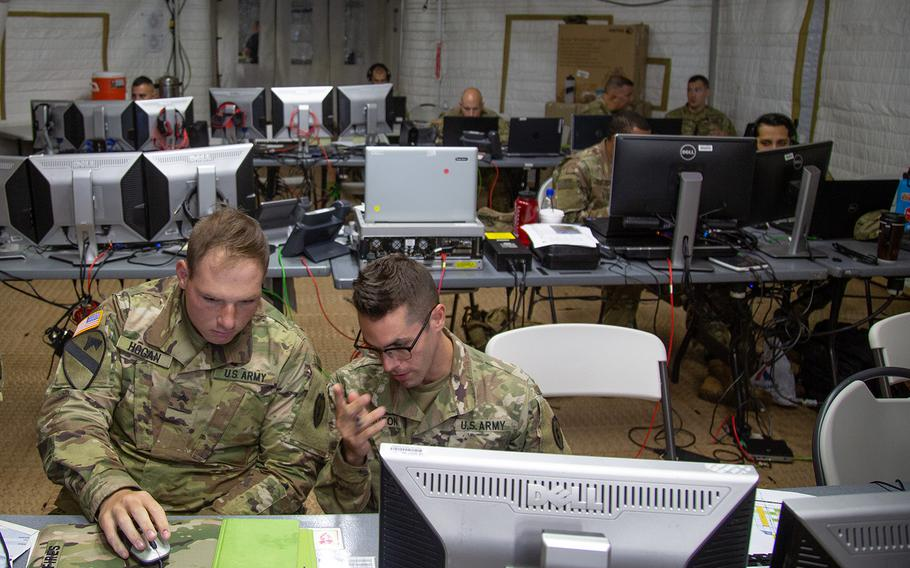 Soldiers working at exercise control at Schofield Barracks, Hawaii, administer the fight during Lightning Forge drills, Sunday, July 22, 2018.