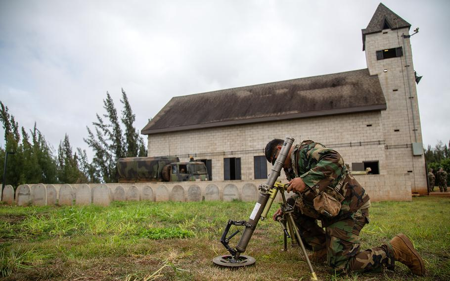 Pfc. Joseph Natividad, 20, a mortarman with the 2nd Battalion, 35th Infantry Regiment, aims his mortar at opposing forces during Lightning Forge at Kahuku Training Area, Hawaii, Sunday, July 22, 2018.
