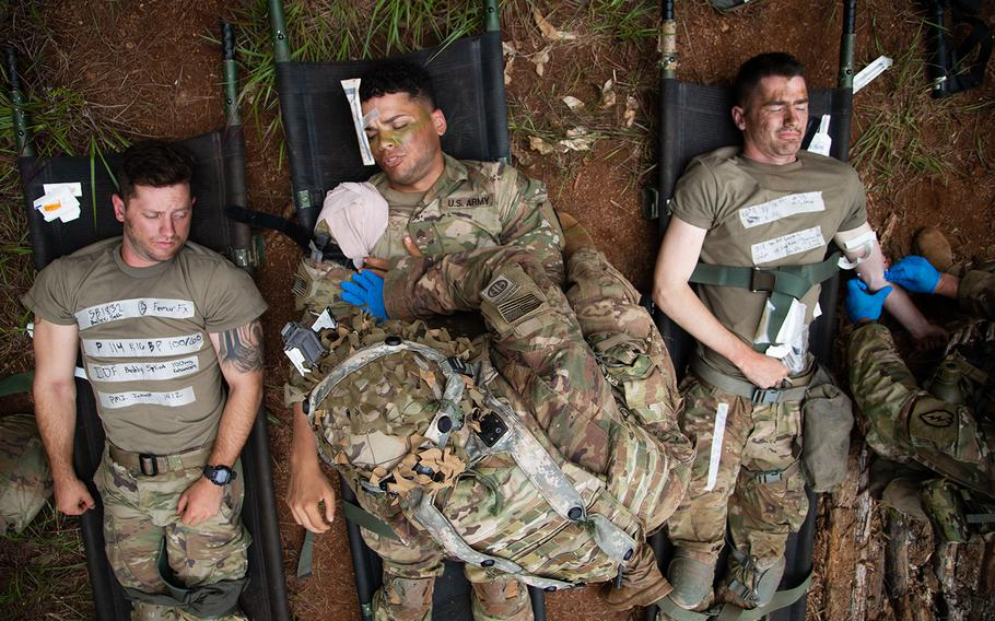 Medics tend to simulated casualties during the Lightning Forge exercise at Kahuku Training Area, Hawaii, Sunday, July 22, 2018.