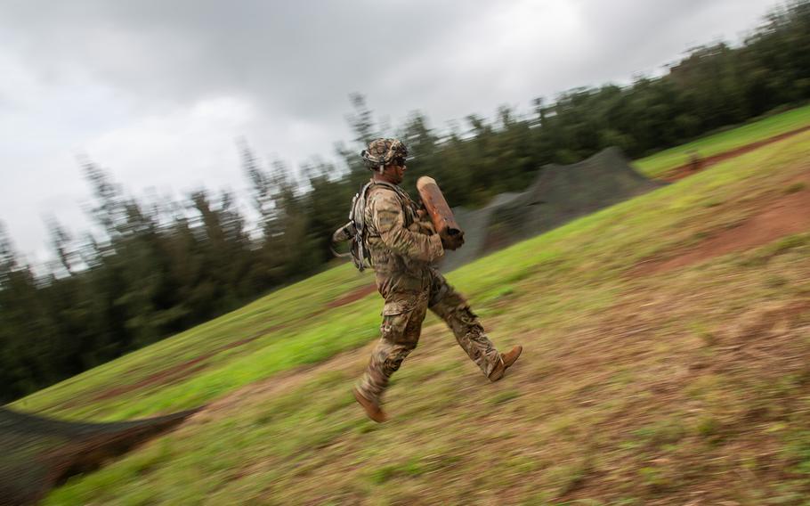 An artilleryman runs ammo during the Lightning Forge exercise at Kahuku Training Area, Hawaii, Sunday, July 22, 2018.