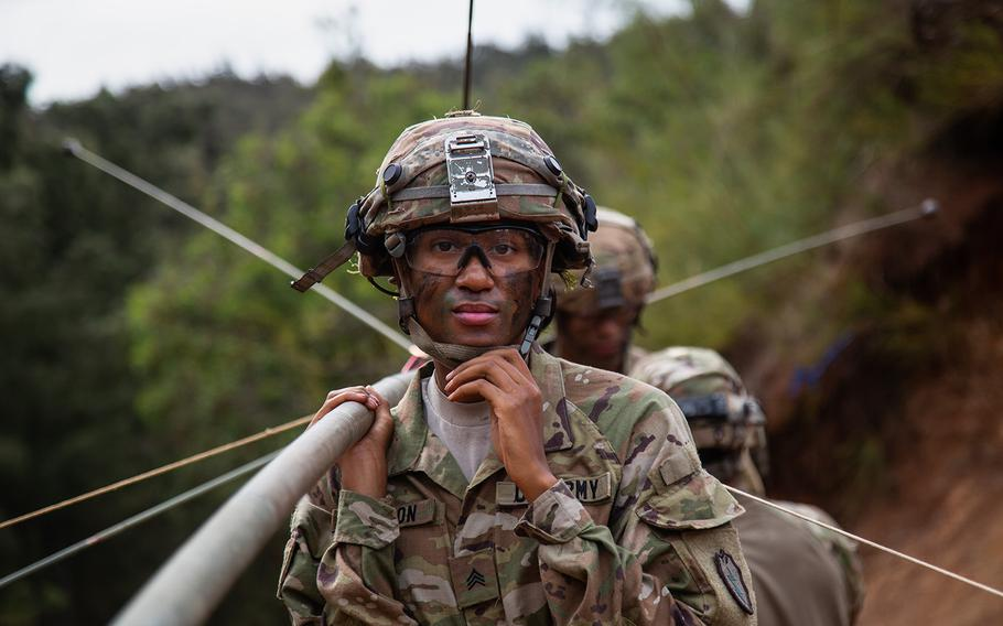 Sgt. Kornisha Sutton, 25, of the 65th Brigade Engineer Battalion, puts up an antenna during the Lightning Forge exercise at Kahuku Training Area, Hawaii, Sunday, July 22, 2018.