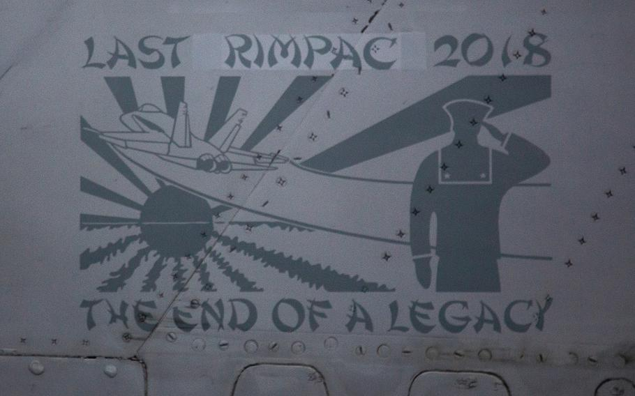 """""""Last RIMPAC 2018,"""" is plastered onto the tail of an F/A-18C Hornet from Strike Fighter Squadron 34 aboard the USS Carl Vinson near Hawaii, Saturday, July 21, 2018."""
