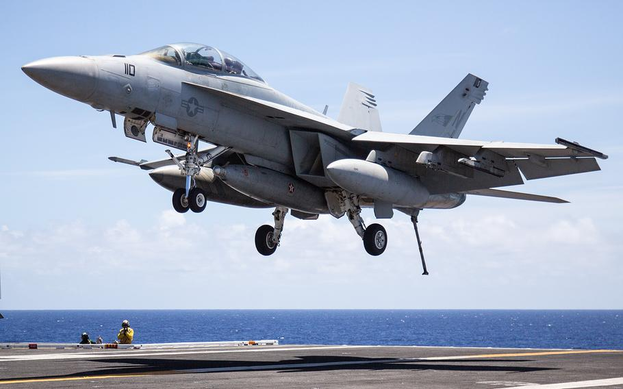 An F/A-18F Super Hornet lands onto the USS Carl Vinson off the coast of Hawaii, Saturday, July 21, 2018.