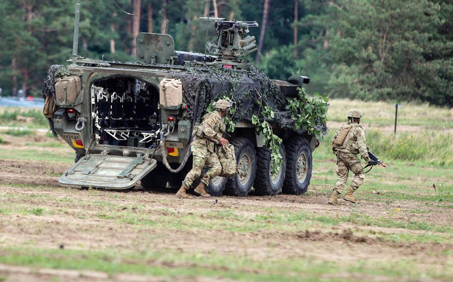 U.S. Army soldiers with the 1st Squadron, 2nd Cavalry Regiment, exit a Stryker during training at Orzysz, Poland. Congress wants the Pentagon to study permanently basing soldiers in the country.