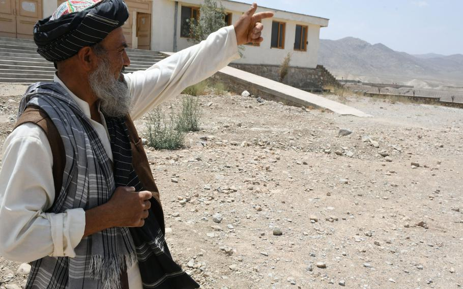Khak-e-Jabar resident Adam Khan on Wednesday, July 18, 2018, points to a village in the distance where the Taliban recently began to operate.