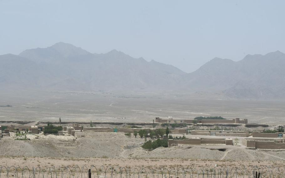 A view from the governor's compound in Khak-e-Jabar district, Kabul province on Wednesday, July 18, 2018. The Taliban have begun operating in a village in the distance.