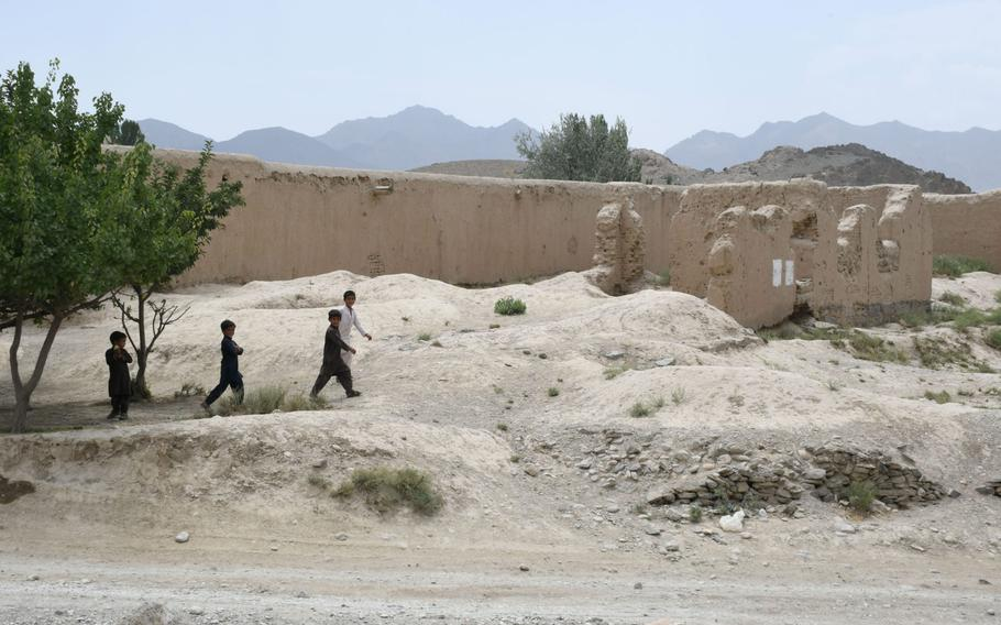 Boys walk in Khak-e-Jabar district, Kabul province on Wednesday, July 18, 2018. The Taliban are said to have taken control of dozens of villages in the district since a U.S.-backed cease-fire by the Afghan government last month.
