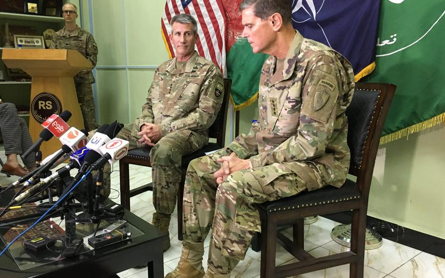 Army Gen. John Nicholson, the top U.S. commander in Afghanistan, left, and Army Gen. Joseph Votel, the commander of U.S. Central Command, speak to reporters in Kabul on Monday, July 23, 2018.
