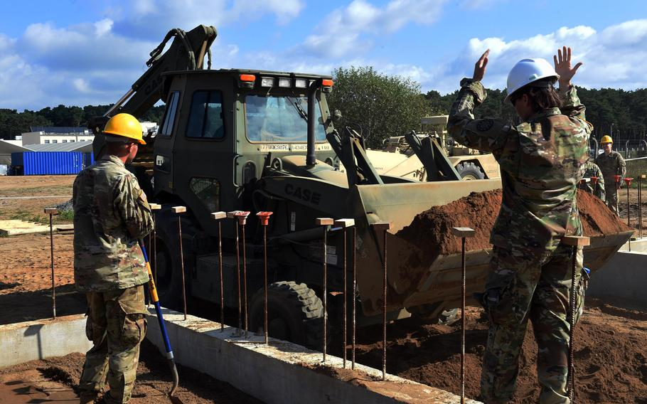 Engineers with the Michigan National Guard construct buildings for the Resolute Castle exercise at the Drawsko Pomorskie Training Area in Poland, Tuesday, July 24, 2018.