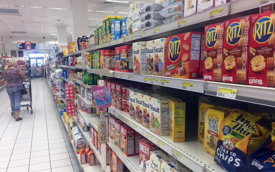 A shopper passes Ritz crackers displayed on an aisle of the main commissary, July 26, 2018, at the U.S. Navy base in Naples, Italy. Most Ritz Bits and Ritz Sandwiches were recalled because of salmonella concerns. They are part of a list of recently recalled commissary items.