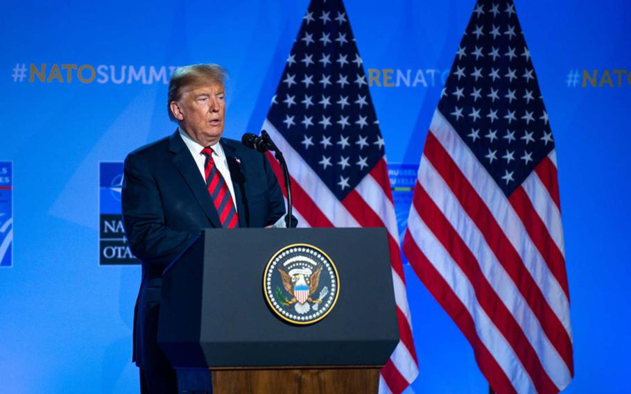 President Donald Trump speaks at a news conference at the NATO summit in Brussels, July 12, 2018. A group of senators has proposed a bill that would prohibit a U.S. president from leaving the alliance without Senate consent.