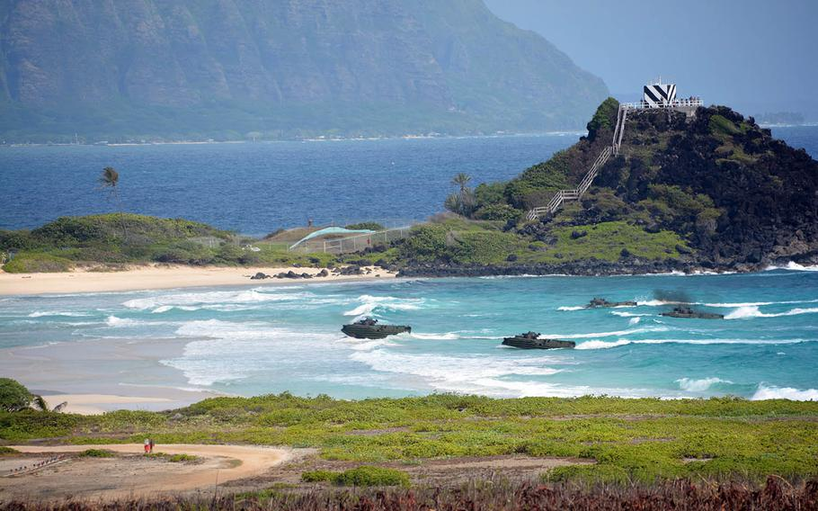 Amphibious-assault craft approach Pyramid Rock Beach at Marine Corps Base Hawaii during a Rim of the Pacific drill, Sunday, July 29, 2018.
