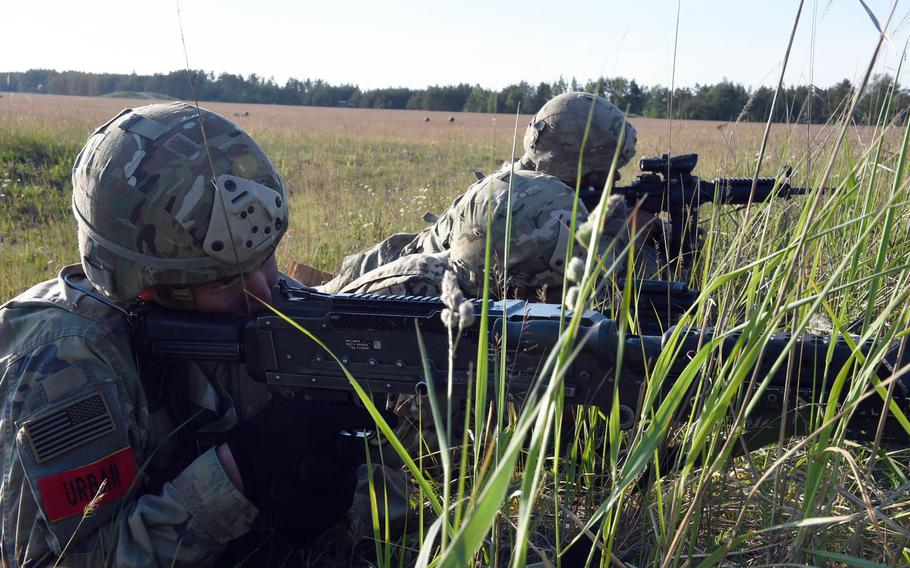 Soldiers with the 173rd Brigade Combat Team (Airborne) provide security during an artillery live-fire exercise at Grafenwoehr, Germany, Friday, May 18, 2018. In a restructuring in Europe, the 7th Army Training Command in Grafenwoehr will now assume oversight of the Vicenza, Italy-based 173rd Airborne Brigade, and the Germany-based 2nd Cavalry Regiment and 12th Combat Aviation Brigade.