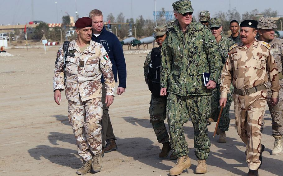 U.S. Navy Admiral James Foggo, commander of Allied Joint Force Command, visits the Iraqi Bomb Disposal School at the Besmaya Range Complex, Iraq, Feb. 7, 2018. Foggo says NATO is sending 200 personnel to Iraq to train security forces to combat the Islamic State.