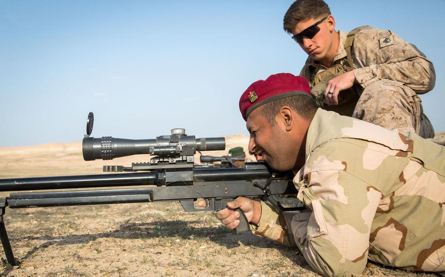 An Iraqi security forces soldier, foreground, practices trigger squeeze on a Steyr HS-50 sniper rifle under the eye of a U.S. Marine Corps scout sniper trainer during marksmanship training at Camp Manion, Iraq, March 28, 2017. NATO is sending 200 personnel to Iraq to train security forces to combat the Islamic State.