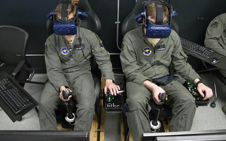 Air Force 2nd Lt. Charles Keller and Airman 1st Class Tyler Haselden, Pilot Training Next students, train on a virtual-reality flight simulator at Armed Forces Reserve Center in Austin, Texas, June 21, 2018.