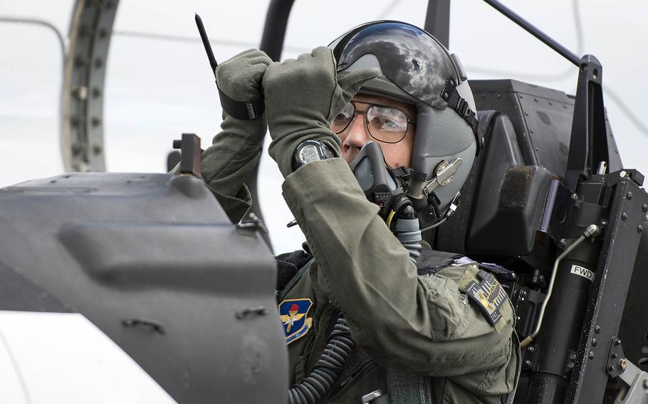 Air Force 2nd Lt. Brett Bultsma, a Pilot Training Next student, gives hand signals to ground maintenance personnel at Austin-Bergstrom International Airport in Austin, Texas, June 18, 2018.