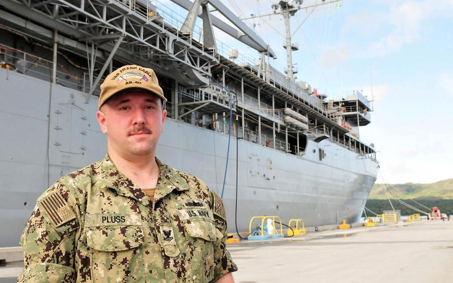 Petty Officer 2nd Class Andrew Pluss of the submarine tender USS Frank Cable was awarded the Navy and Marine Corps Achievement Medal for his actions after a fatal car crash last month on Guam.