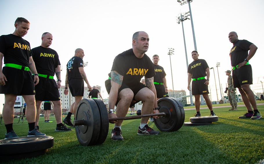 A soldier from the 1st Armored Combat Brigade, 3rd Infantry Division attempts a deadlift during a demo of the new Army Combat Fitness Test at Camp Humphreys, South Korea, Tuesday, July 31, 2018.