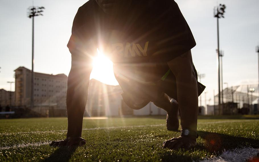 A soldier from the 1st Armored Combat Brigade, 3rd Infantry Division completes a pushup during a demo of the new Army Combat Fitness Test at Camp Humphreys, South Korea, Tuesday, July 31, 2018.