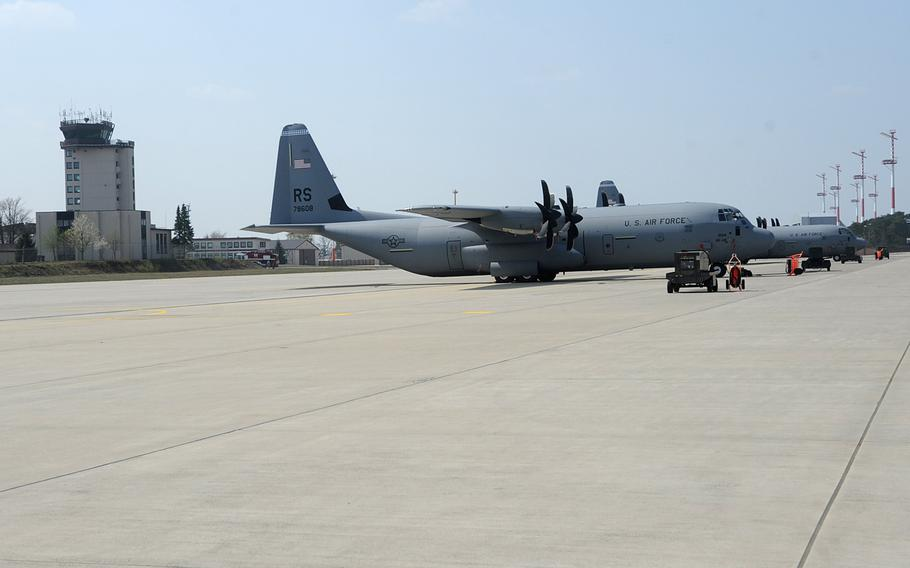 A pair of C-130 Hercules cargo planes sit on the tarmac at Ramstein Air Base, Germany. U.S. military bases in Europe rely heavily on host nation energy, which in turn often relies on Russian oil and gas.