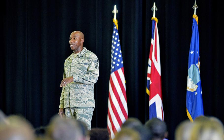 Chief Master Sergeant of the Air Force Chief Kaleth O. Wright speaks to airmen about coming policy changes during a town hall at RAF Lakenheath, England, Wednesday, Aug. 1, 2018.
