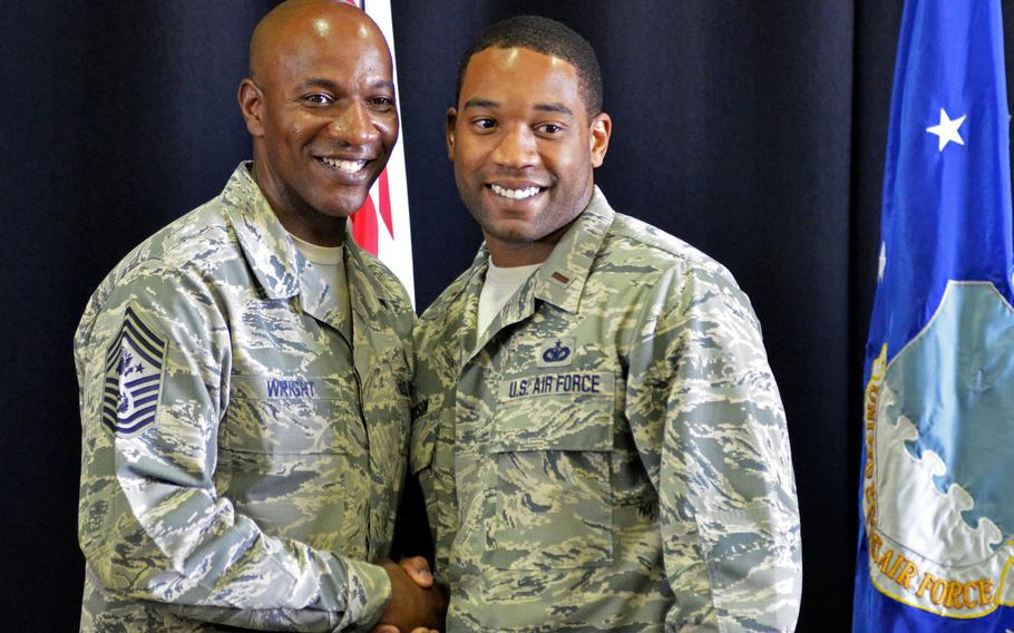 Chief Master Sergeant of the Air Force Chief Kaleth O. Wright poses for a photograph with an officer after a town hall at RAF Lakenheath, England, Wednesday, Aug. 1, 2018. More than 1000 airmen gathered to hear about coming policy changes to improve their quality of life.