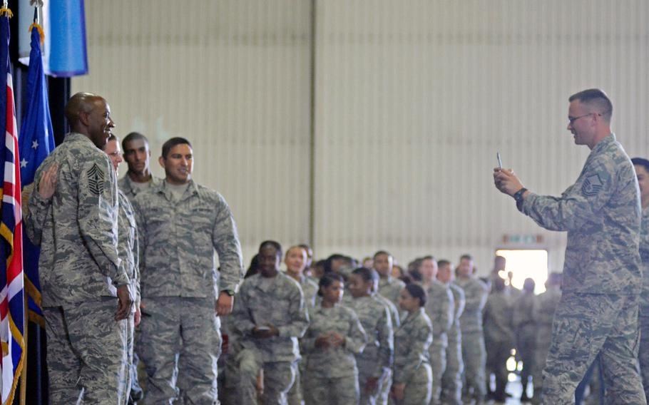 Airmen line the wall of a hangar for photographs with Chief Master Sergeant of the Air Force Chief Kaleth O. Wright, after a townhall at RAF Lakenheath, England, Wednesday, August 1, 2018.
