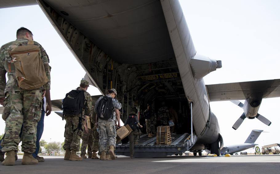 Exercise Flintlock 2018 participants board a C-130H Hercules from the West Virginia Air National Guard, April 11, 2018, at Diori Hamani International Airport, Niger. U.S. Africa Command wants to pull hundreds of troops from Africa and downsize special operations missions.