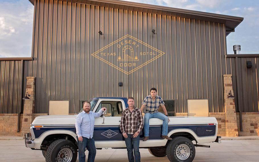 Ryan Campbell, Brent Looby and Judson Kauffman in front of the Desert Door Distillery tasting room.