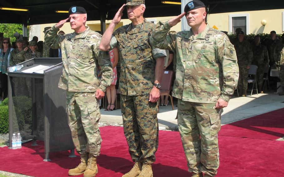 Brig. Gen. Eugene LeBoeuf, Marine Gen. Thomas Waldhauser and Maj. Gen. Roger Cloutier, from left, stand before soldiers gathered on the Caserma Ederle parade field Thursday, Aug. 3, 2018, at the start of U.S. Army Africa's change-of-command ceremony. Cloutier took over from Le Boeuf, acting commander for the past year.