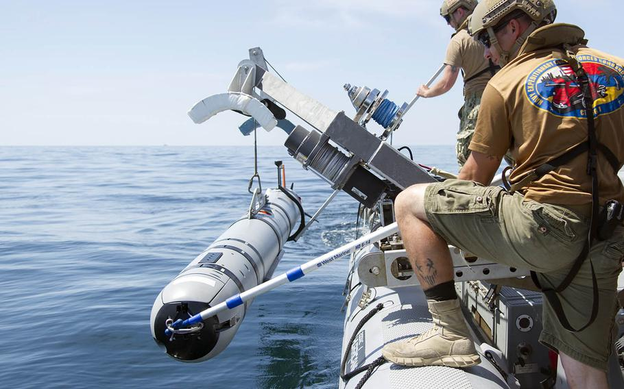 Sailors lower an unmanned underwater vehicle into the sea during a mine-countermeasures drill near Panama City, Fla., May 14, 2016.