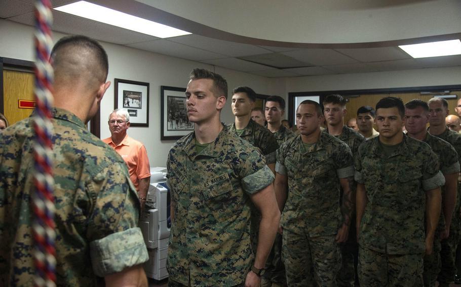 Lance Cpl. Dillon Bennett, machine gunner, 3rd Battalion, 7th Marine Regiment, receives a Purple Heart from Col. Kyle B. Ellison, commanding officer, 7th Marine Regiment, at 7th Marines' Headquarters aboard the Marine Corps Air Ground Combat Center, Twentynine Palms, Calif., July 27, 2018.