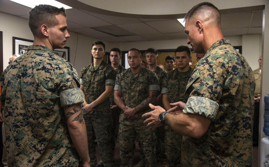 Col. Kyle B. Ellison, commanding officer of the 7th Marine Regiment, right, speaks about the actions and the esprit de corps that Lance Cpl. Dillon Bennett, machine gunner, 3rd Battalion, 7th Regiment, displayed following the presentation of a Purple Heart to Bennett at 7th Marines' Headquarters.