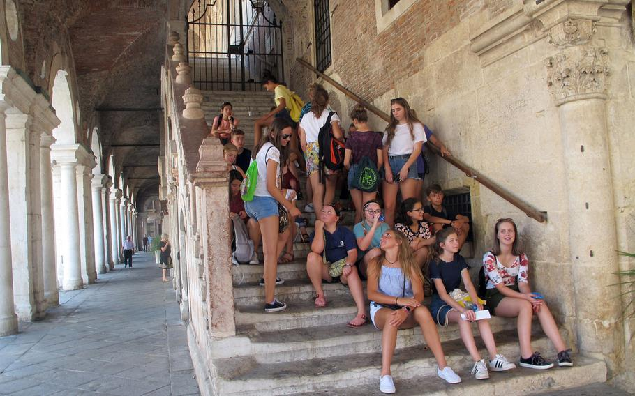 A group of American teens gather on the steps of Vicenza's Basilica Palladiana during one of several city tours provided each summer by U.S. Army Garrison Italy for newly arrived middle- and high-school students.