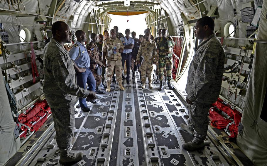 Military members from seven African countries are shown a C-130 during the African Partnership flight at Ramstein Air Base, Germany, Tuesday, Aug. 7, 2018. The weeklong engagement aims to build relationships.