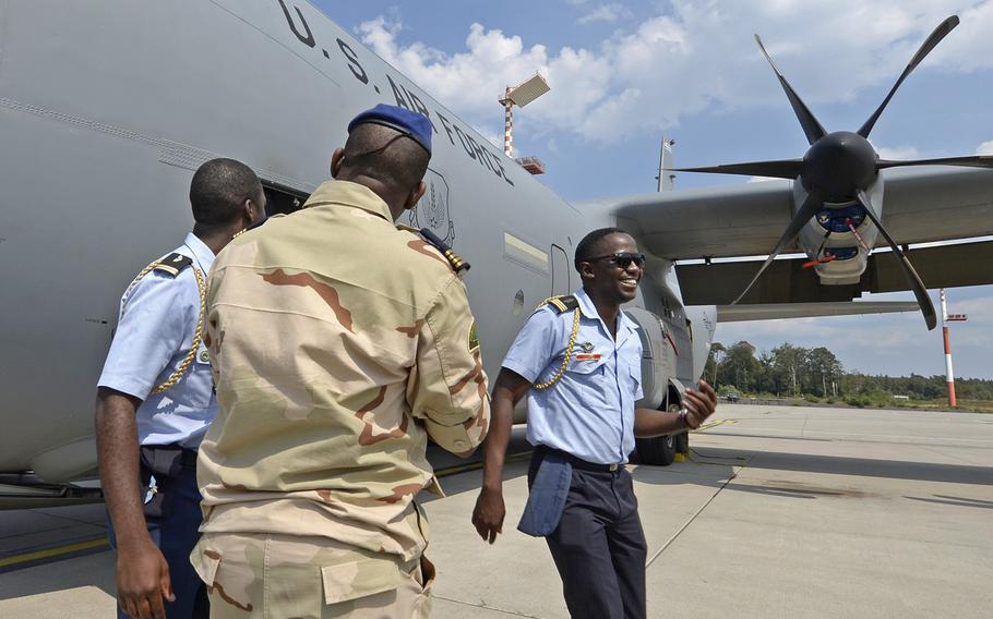 Military members from African countries are shown next to a C-130 during the African Partnership flight at Ramstein Air Base, Germany, on Tuesday, Aug. 7, 2018. The weeklong engagement focuses on force development.