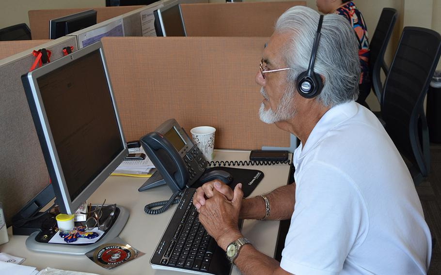 Jose Cabello, a Marine Corps veteran and call specialist with 211, answers a call at the United Way of San Antonio and Bexar County in Texas on July 6, 2018.
