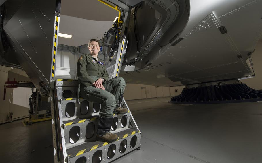 Col. Kathryn Hughes, a pilot-physician and director, Human Systems Integration, 711th Human Performance Wing, sits on the stairs of a centrifuge at Wright-Patterson Air Force Base, Ohio, April 22, 2016. Hughes, an A-10 Thunderbolt II pilot, was instrumental in the integration of the full-coverage G-suit into the Air Force inventory.
