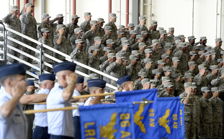 Airmen from the 86th Airlift Wing salute during the wing change-of-command ceremony at Ramstein Air Base, Germany, Thursday, Aug. 9, 2018. Brig. Gen. Mark R. August took over command from Brig. Gen. Richard G. Moore Jr.