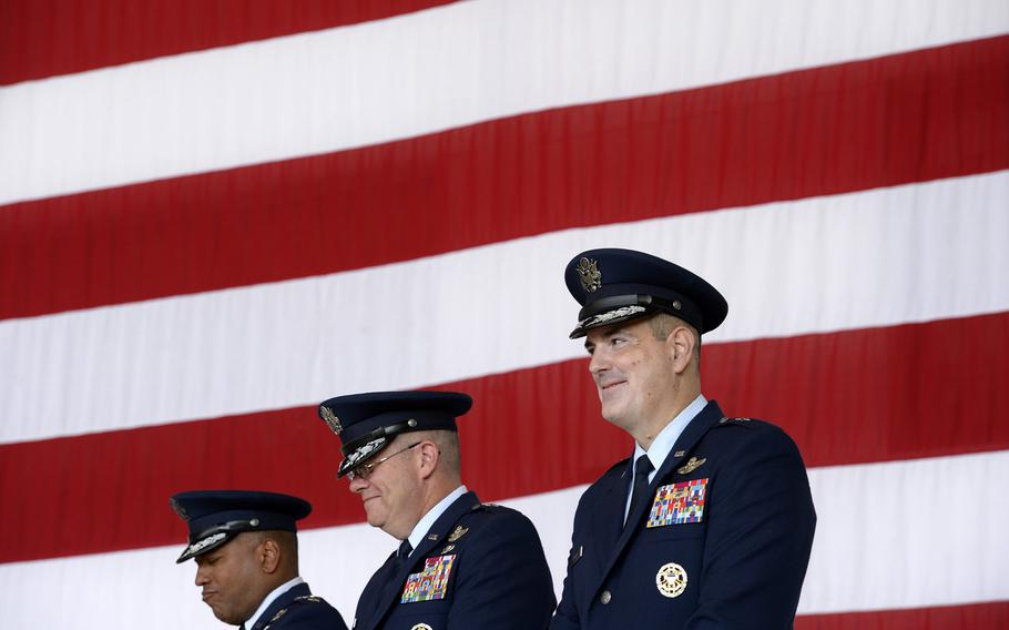Brig. Gen. Mark R. August, right, smiles during the 86th Airlift Wing change-of-command ceremony at Ramstein Air Base, Germany, Thursday, Aug. 9, 2018. August took over command from Brig. Gen. Richard G. Moore Jr.