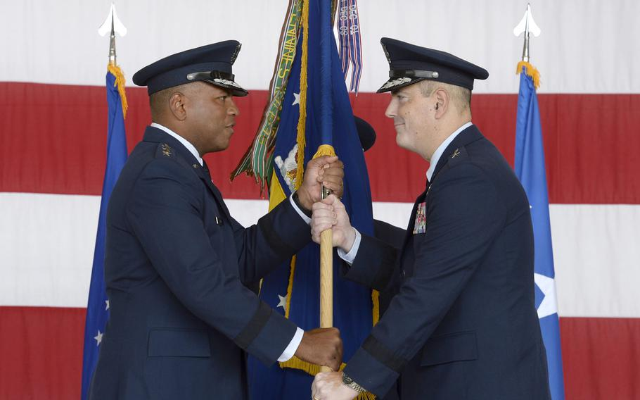 Brig. Gen. Mark R. August, right, takes the flag from Lt. Gen. Richard M. Clark, commander of 3rd Air Force, during the 86th Airlift Wing change-of-command ceremony at Ramstein Air Base, Germany, Thursday, Aug. 9, 2018. August took over command from Brig. Gen. Richard G. Moore Jr.