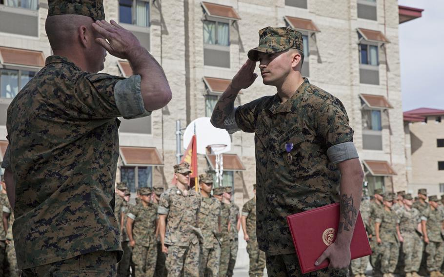 U.S. Marine Corps Sgt. Cameron T. Halkovich, right, a combat engineer with 1st Combat Engineer Battalion, 1st Marine Division, salutes Lt. Colonel Christopher Haar, the commanding officer of 1st CEB, at Marine Corps Base Camp Pendleton, Calif., April 24, 2018. Halkovich was awarded the Purple Heart for wounds received in action on Feb. 17, 2018, in support of operation Inherent Resolve.