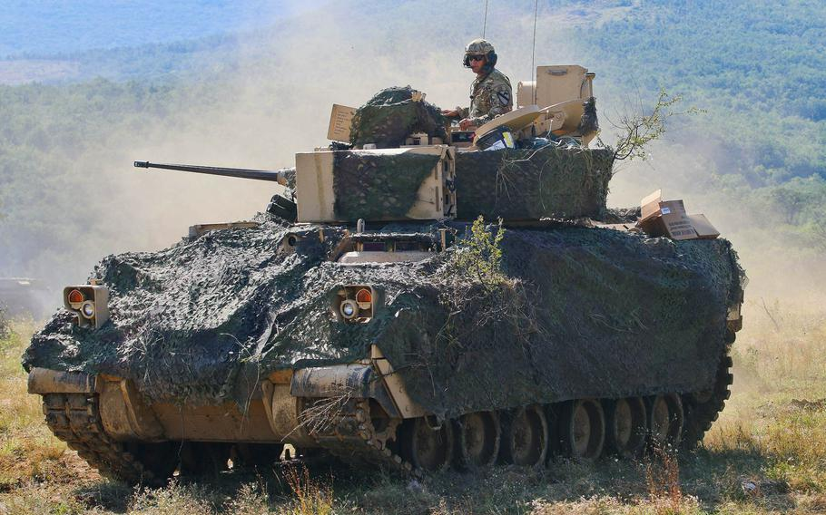 U.S. Army Sgt. Ansel Frayer of 1st Armored Brigade Combat Team and his crew, maneuver their M2A3 Bradley during Exercise Platinum Lion, an annual exercise at Novo Selo Training Area, Bulgaria, Aug. 2, 2018.
