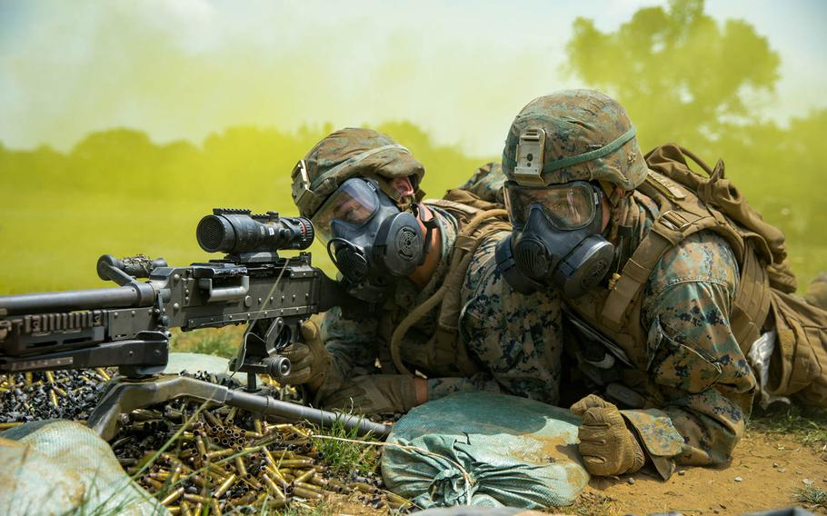 U.S. Marines with Black Sea Rotational Force don gas masks and prepare to engage targets during Exercise Platinum Lion 18 at Novo Selo Training Area, Bulgaria, Aug. 3, 2018.