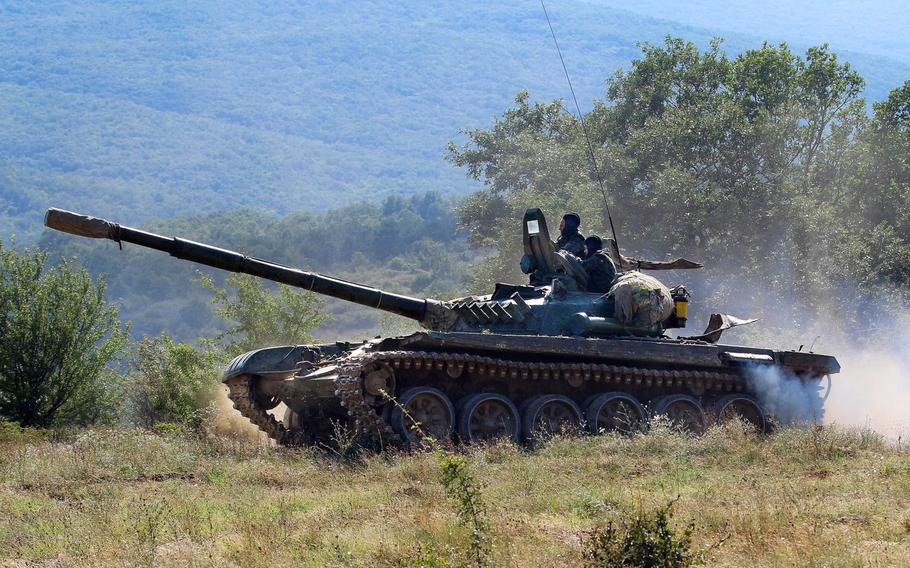 Bulgarian Soldiers maneuver their T-72 tank to higher ground during exercise Platinum Lion, an annual drill with partner nations, at Novo Selo Training Area, Bulgaria, Aug. 2, 2018.